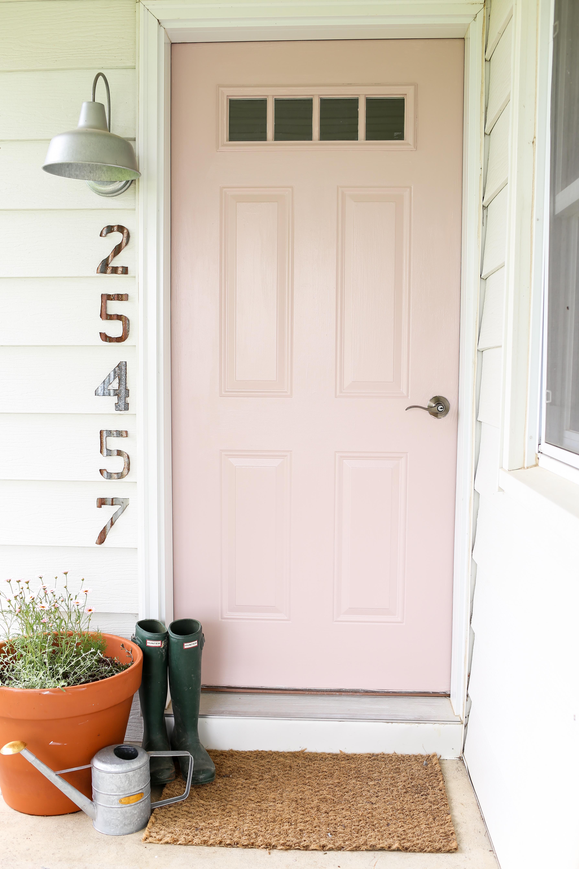 Blush pink front door.