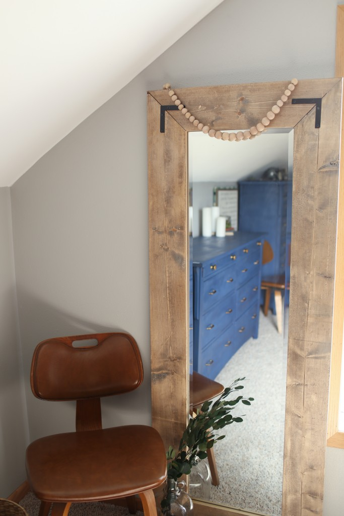 Create a large floor mirror with a modern farmhouse look from a basic door mirror.  An inexpensive DIY from The Dempster Logbook.