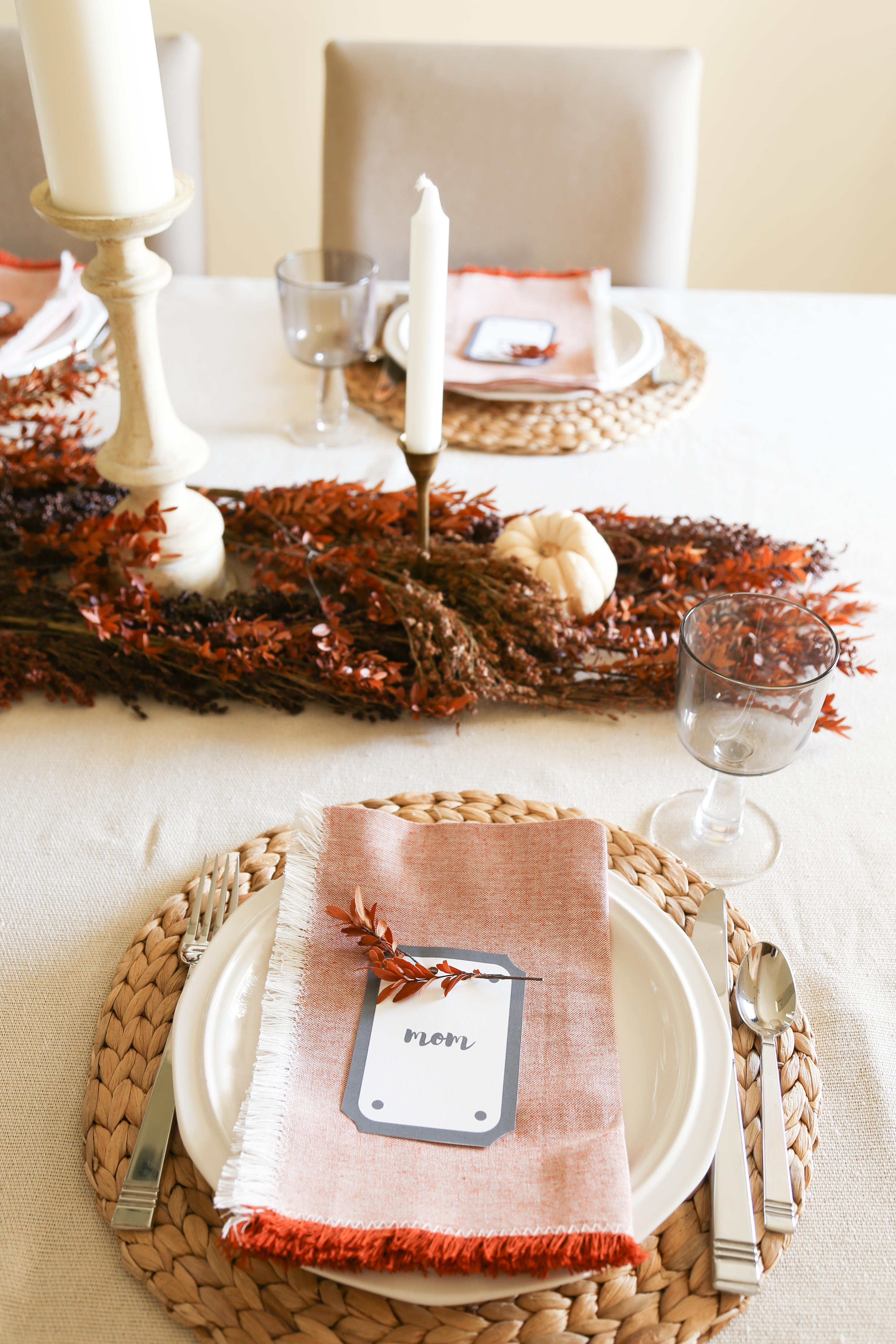 Decorate for thanksgiving using dried stems as a simple and elegant table runner.
