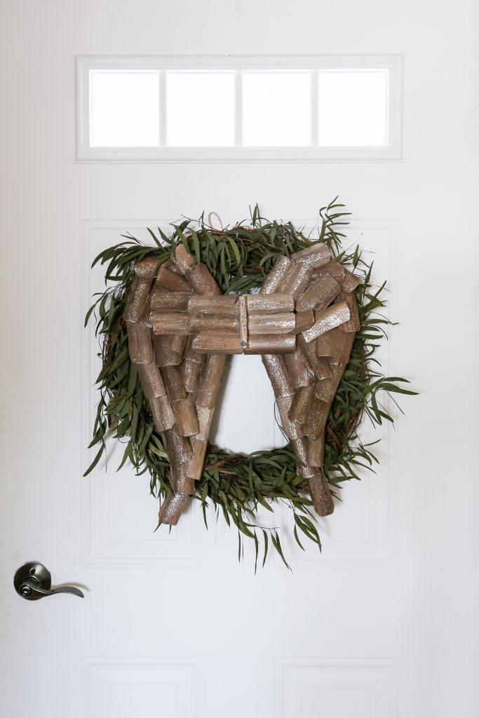 The eucalyptus willow wreath is dressed up with wooden wings for Christmas at the farmhouse.
