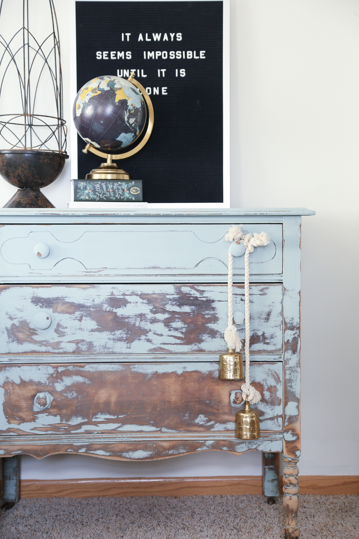 A dresser is painted and then distressed to give it a balayage effect.  Homestead 128.