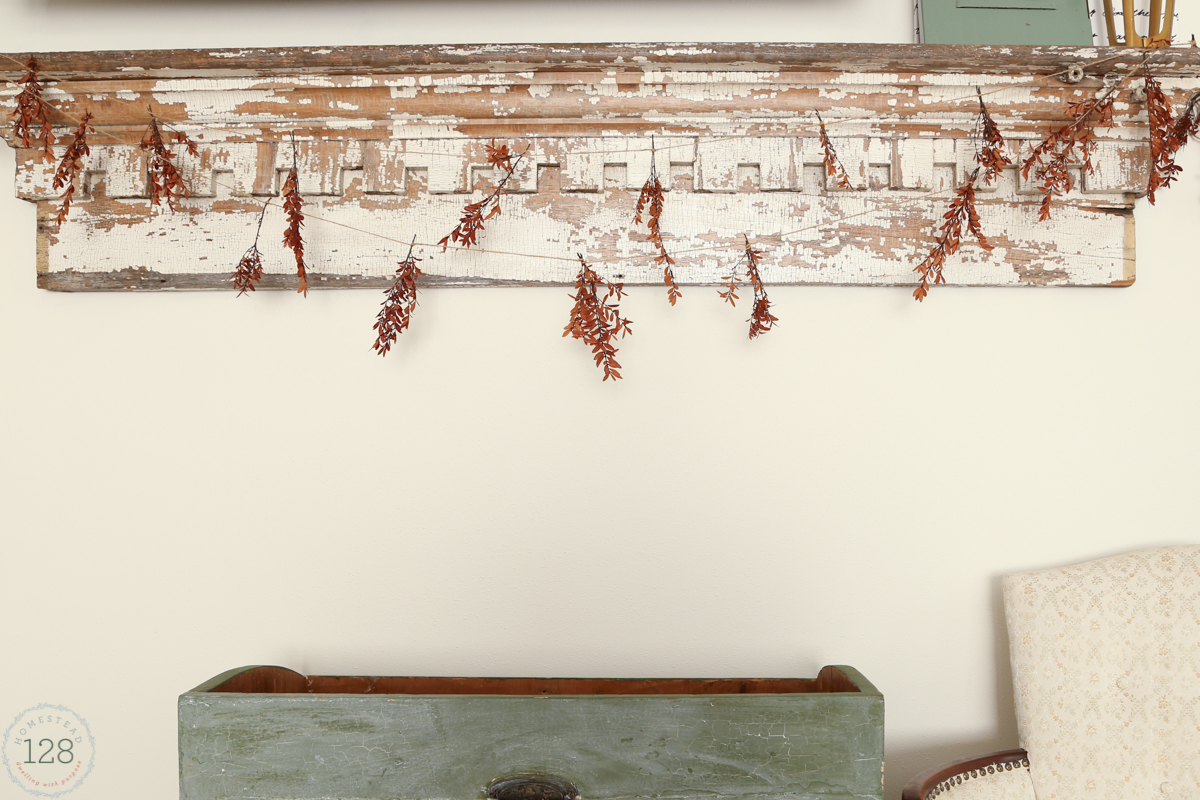 Simple garland with dried natural stems and jute twine spruce up the mantle for fall.