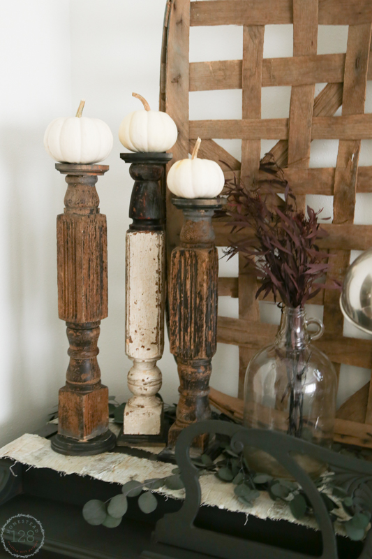 Rustic table legs for candlesticks and white pumpkins.