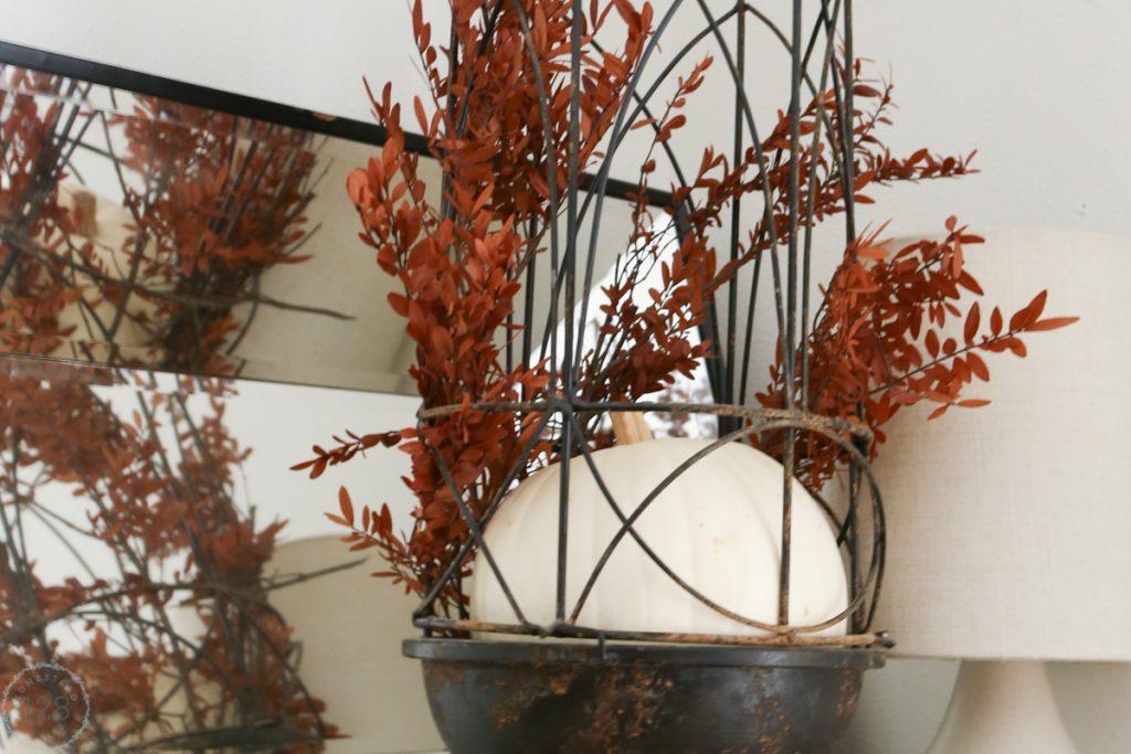 White pumpkin and orange natural stems dress up the farmhouse.