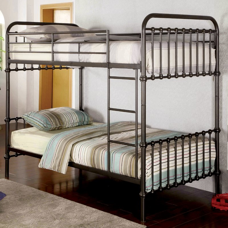 Double over double bunk bed in a vintage metal style.
