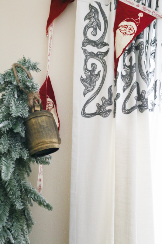 Miniature flocked trees and red Santa bunting fill the corners for the farmhouse at Christmas.