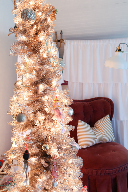 Farmhouse Christmas decorating. Girls bedroom decorated for Christmas with a rose gold tree.