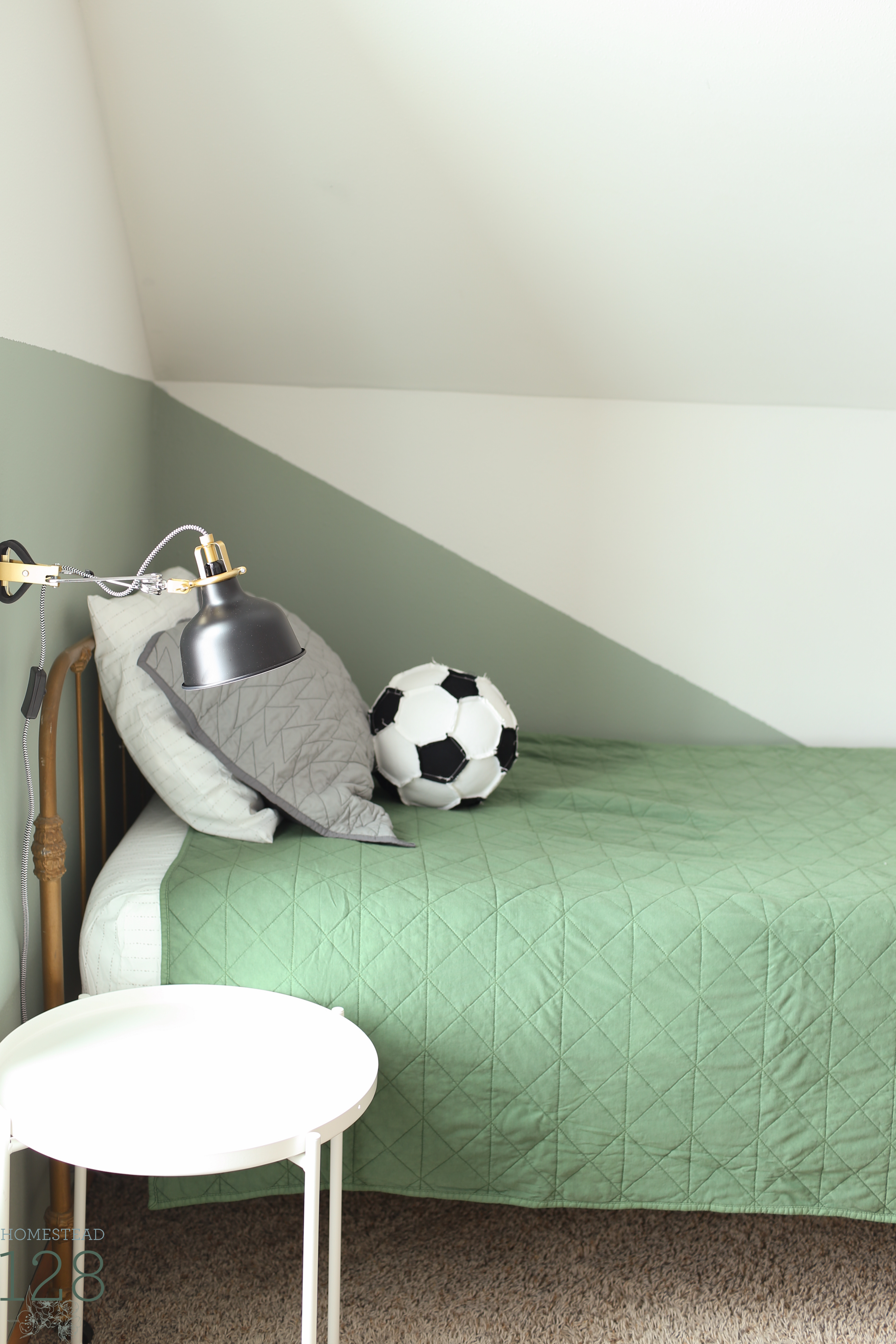 The boys vintage industrial shared bedroom brings in green, gray and white for a color scheme they can grow into.