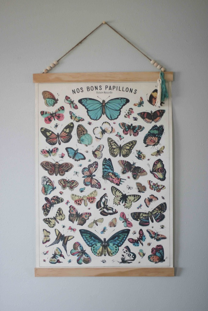 Create your own poster frame to hang large prints.  DIY steps from www.homestead128.com