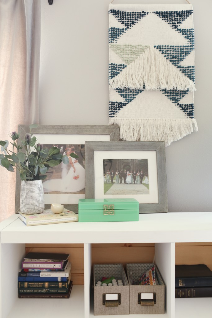 Ikea shelves with DIY plank backing and woven wall art. The Dempster Logbook.