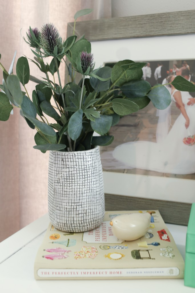 Grid pattern vase with faux eucalyptus. The Dempster Logbook.