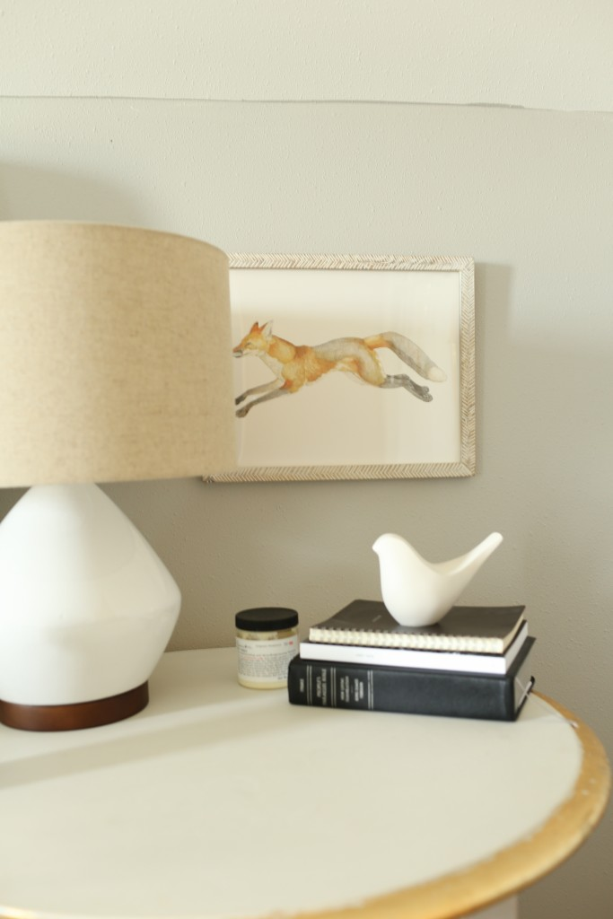 Gray and gold nightstand with fox art. The Dempster Logbook.