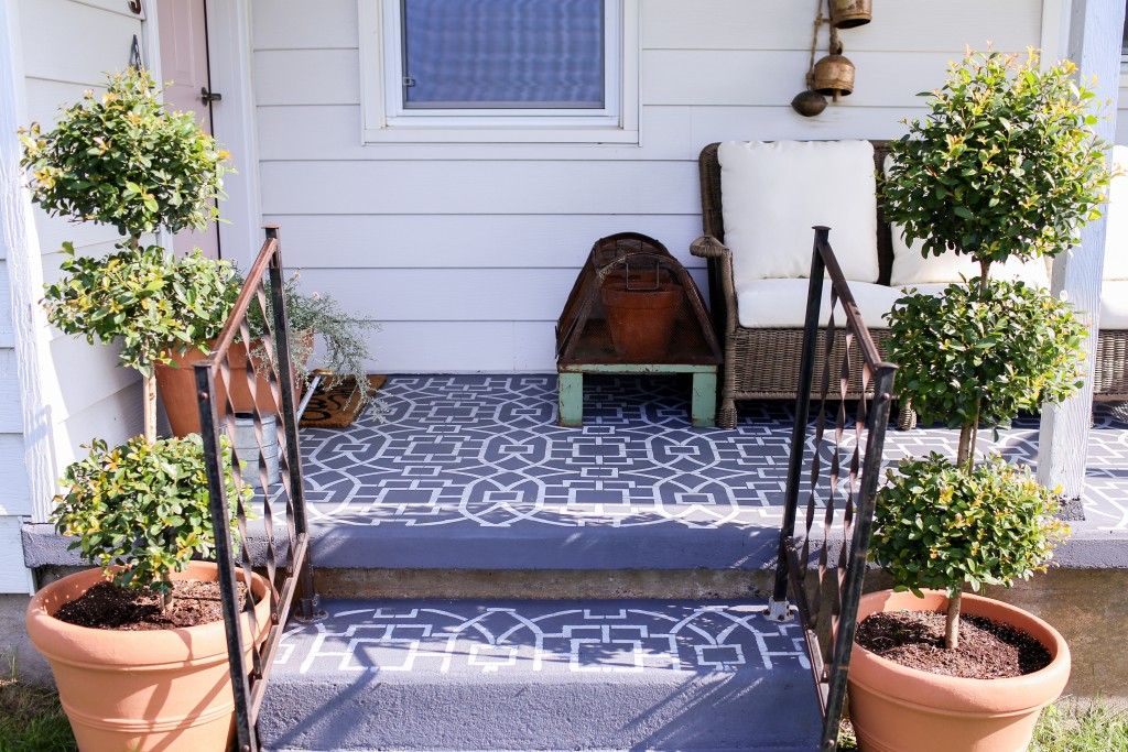 Cement tile look with stenciling for the farmhouse front porch.