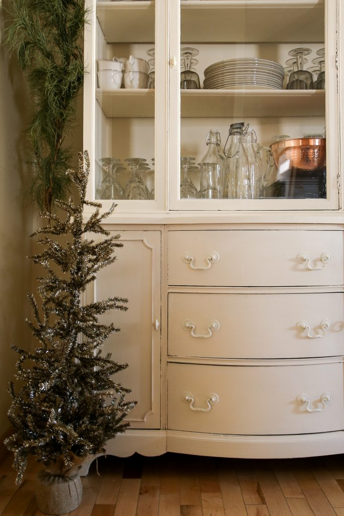 A gold tinsel Christmas tree dresses up the farmhouse.