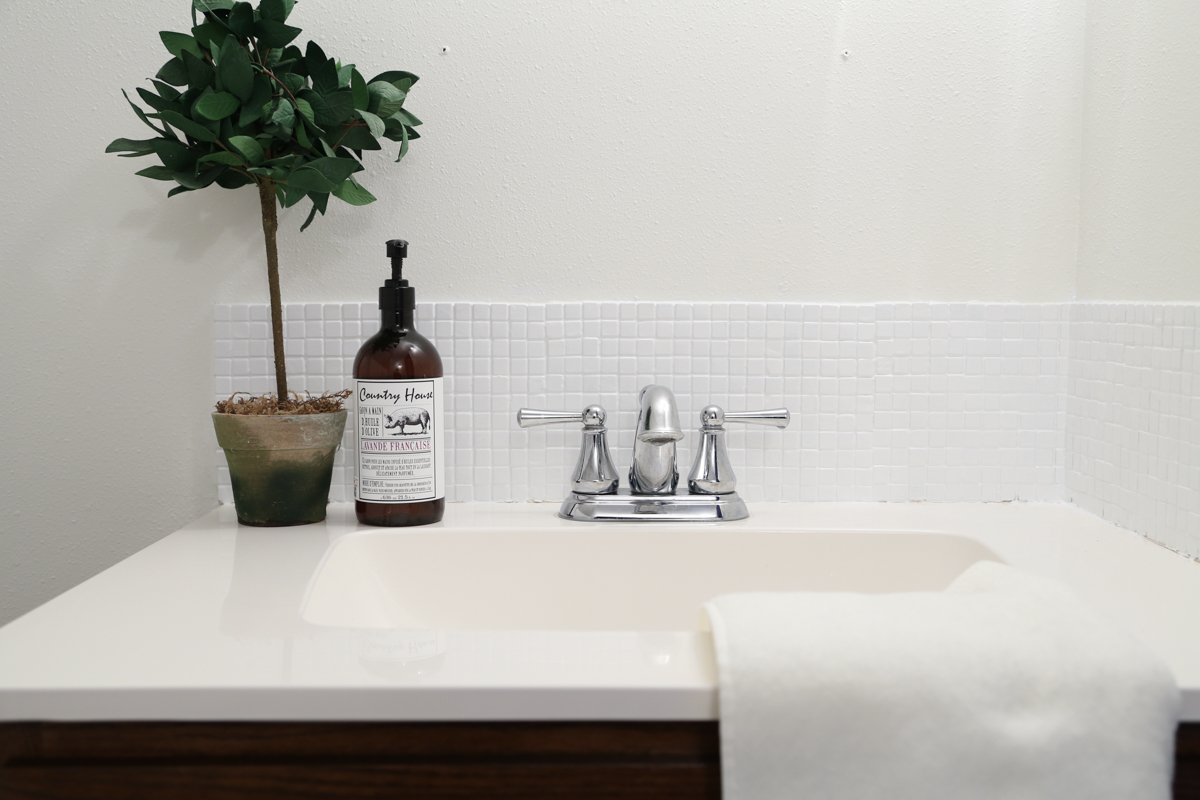 A bathroom backsplash is painted a bright white for a fresh and bright update. From Homestead 128.