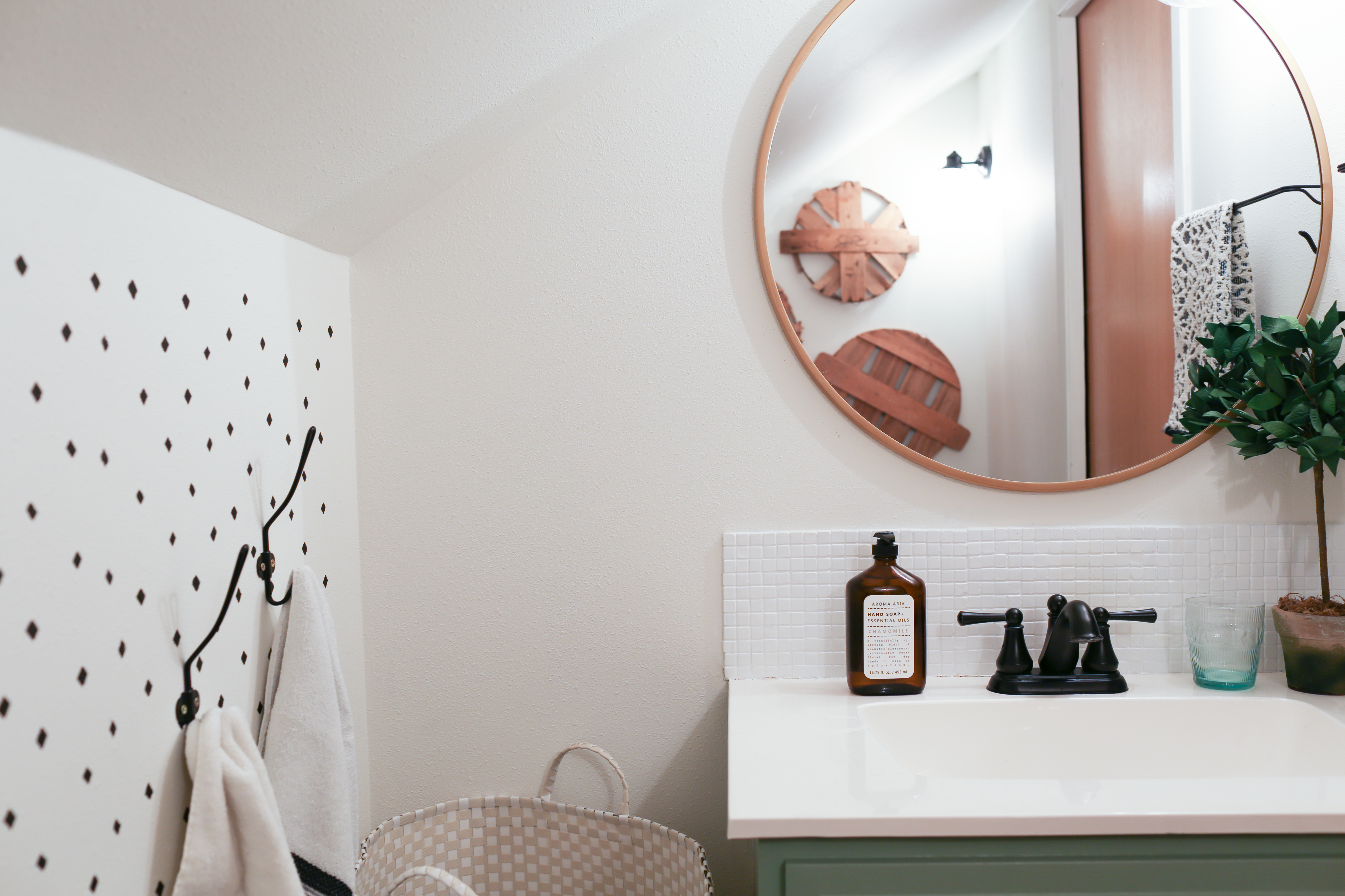 The small bathroom is updated to reflect the modern farmhouse look.