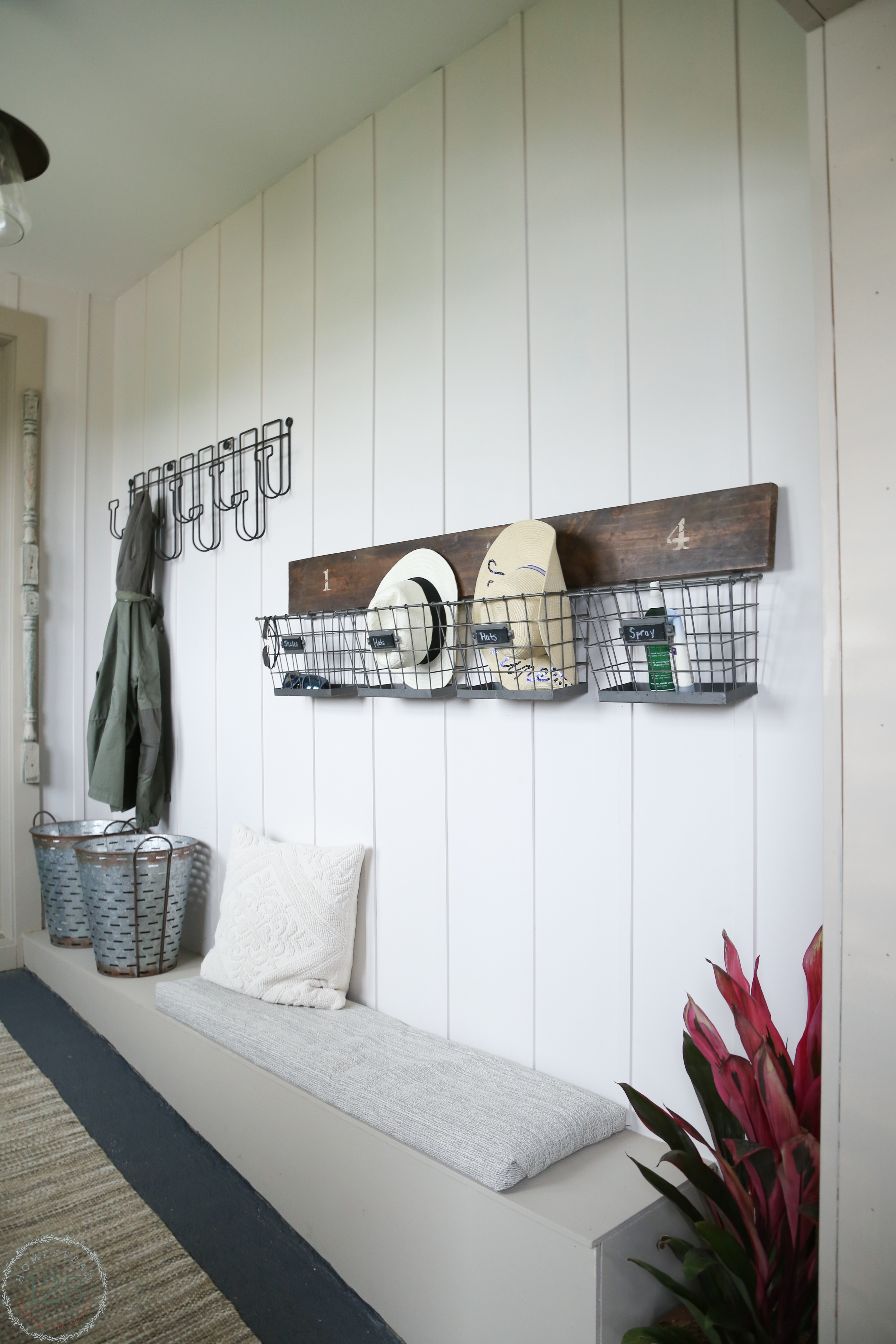 Farmhouse mudroom make from an old walkway. Batten trimmed walls, built in benches, all with modern and vintage touches.