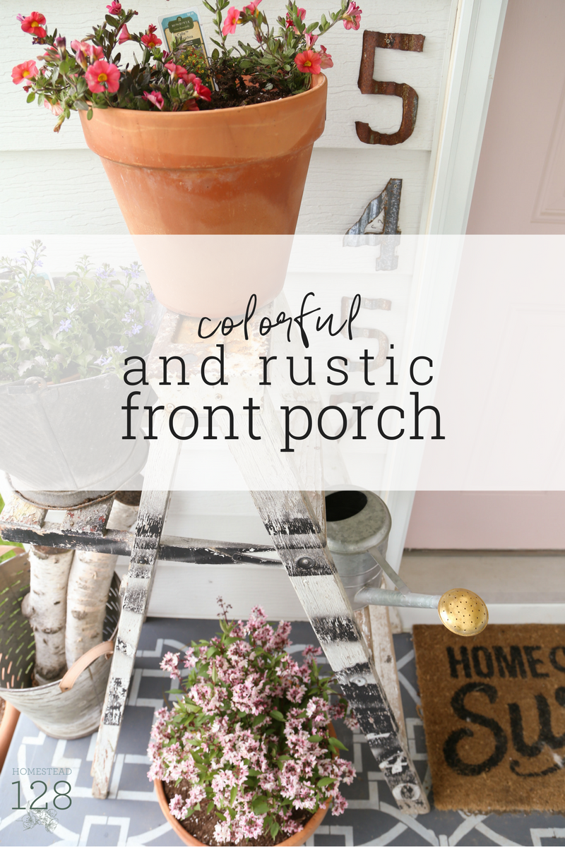 Our colorful and rustic farmhouse front porch. Beautiful plants and rustic elements bring give the space a welcoming farmhouse feel.