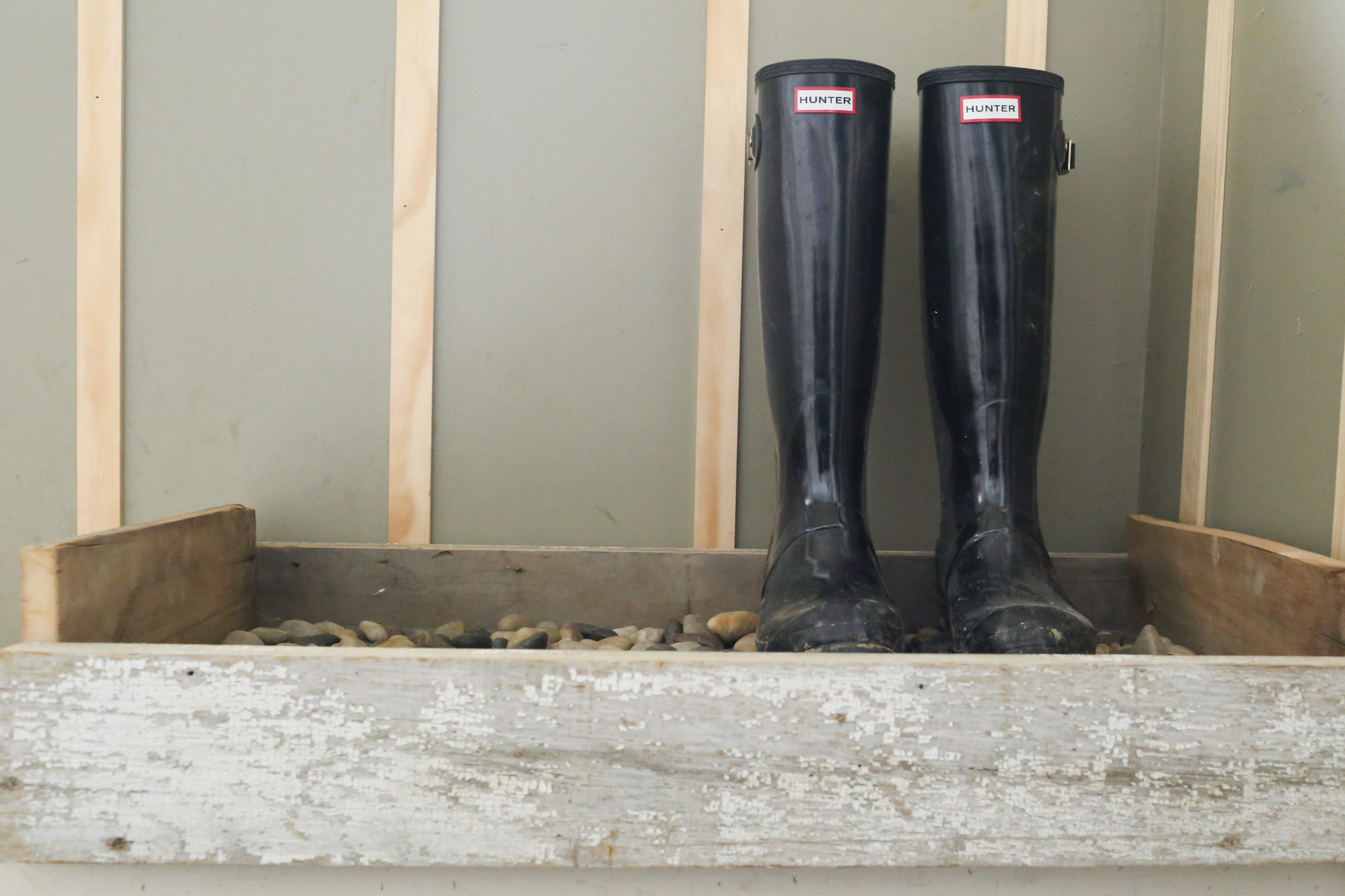 The farmhouse boot tray helps drain the boots and keeps them in place in style.