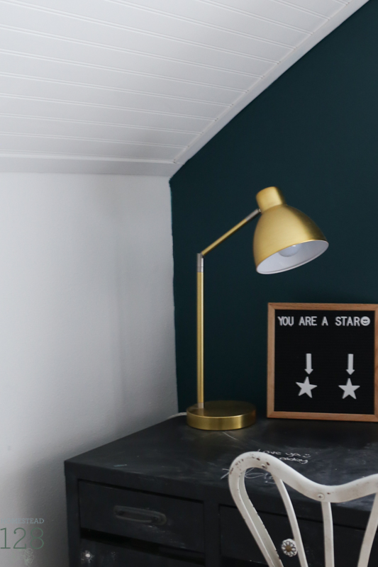 Ikea desk covered with chalkboard paint gives the desk a matte black finish and is extra fun for kids bedroom.