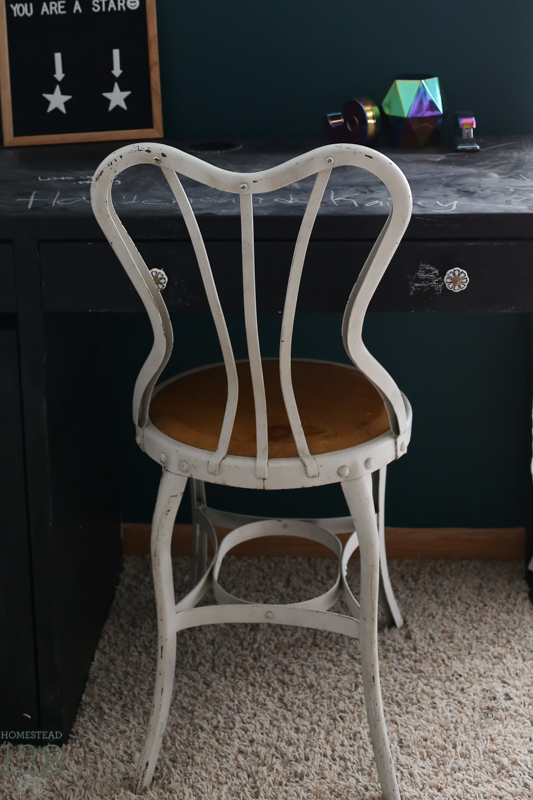 Vintage ice cream shop chair used as a desk chair.