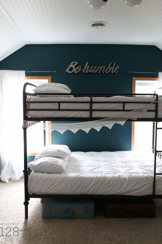 Vintage and glam shared girl bedroom. Dark teal walls and headboard ceiling.