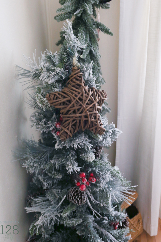 Miniature flocked trees fill the corners for the farmhouse at Christmas.