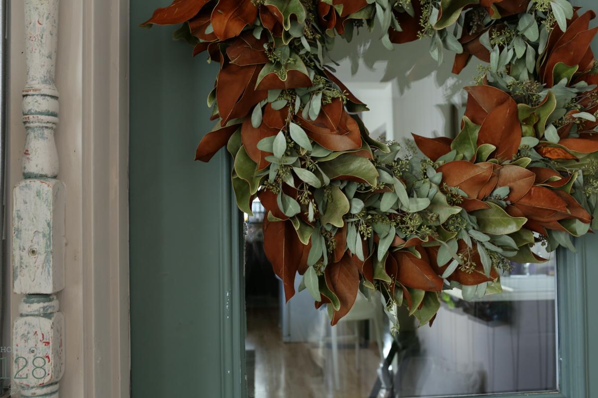 Christmas at the farmhouse with a magnolia and seeded eucalyptus wreath.