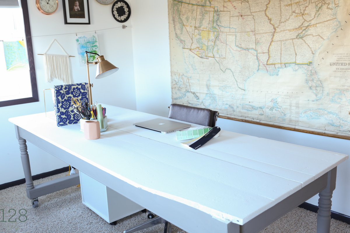 Harvest table is turned into a working office desk with help fro rolling storage drawers, task lighting and a power cube outlet.