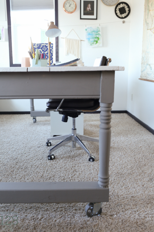 Harvest table is restored and casters added to make it a working office table.