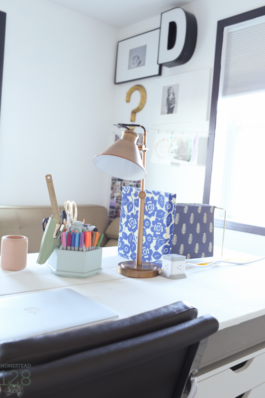 Task lighting and a power cube make the table functional as a working desk.