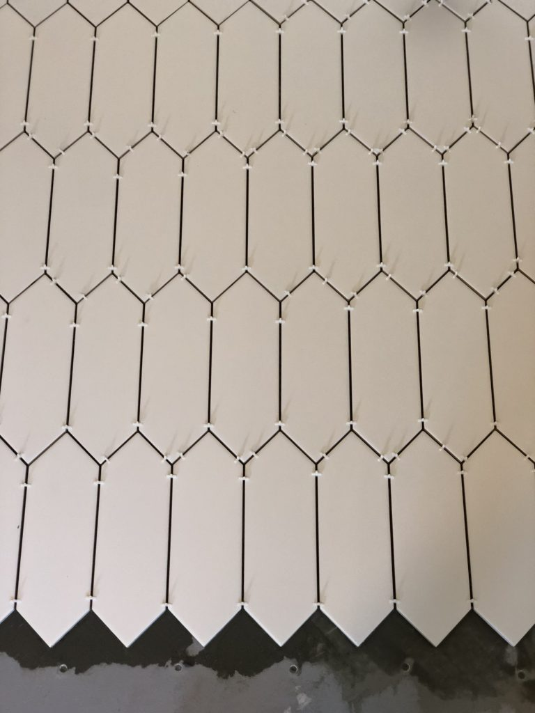 Modern hexagon white tile for the farmhouse laundry room.